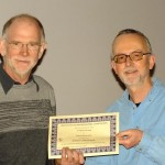 Martin Ridout receiving his certificate from Glyn